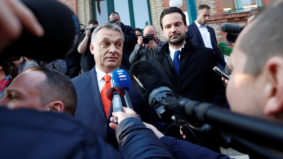 Current Hungarian Prime Minister Viktor Orban surrounded by microphones