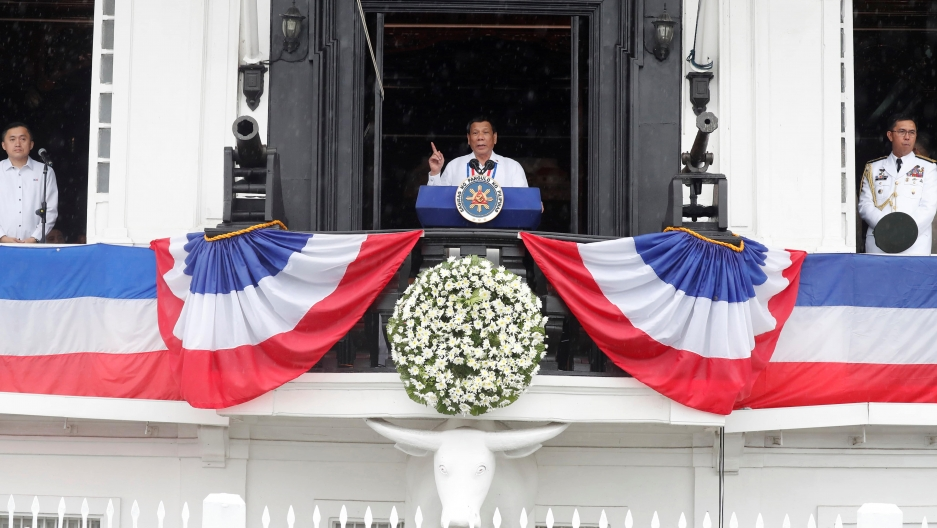 Philippine's President Rodrigo Duterte speaks from a balcony