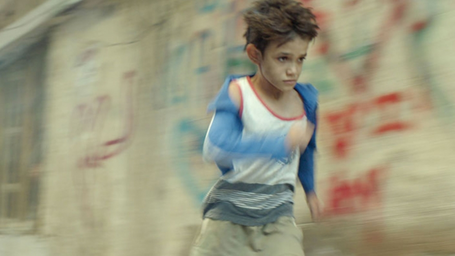 A boy in a blur running.