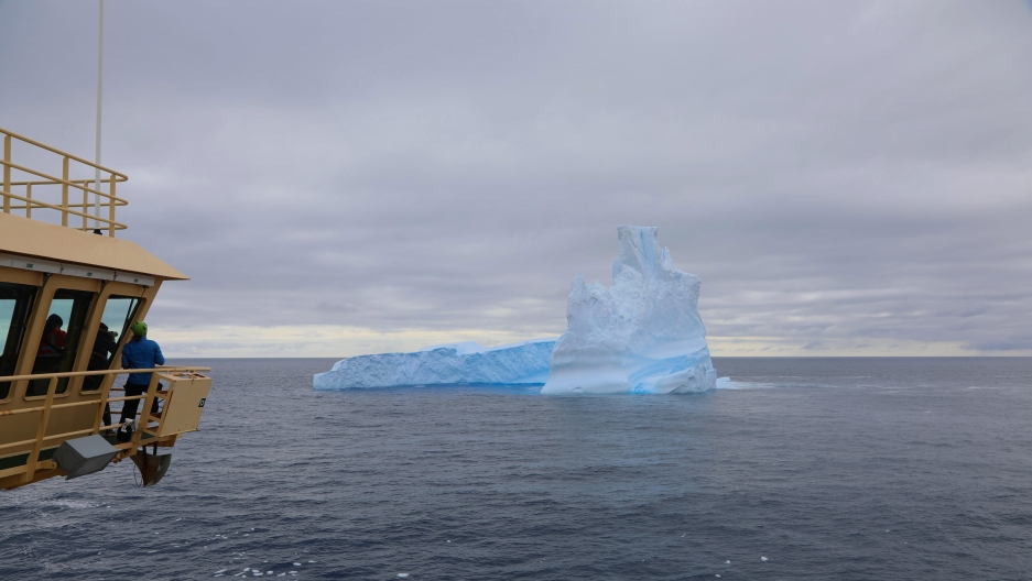 Researchers aboard the Nathanial B. Palmer gather on the ship's bridge to view one of the first icebergs they encountered.