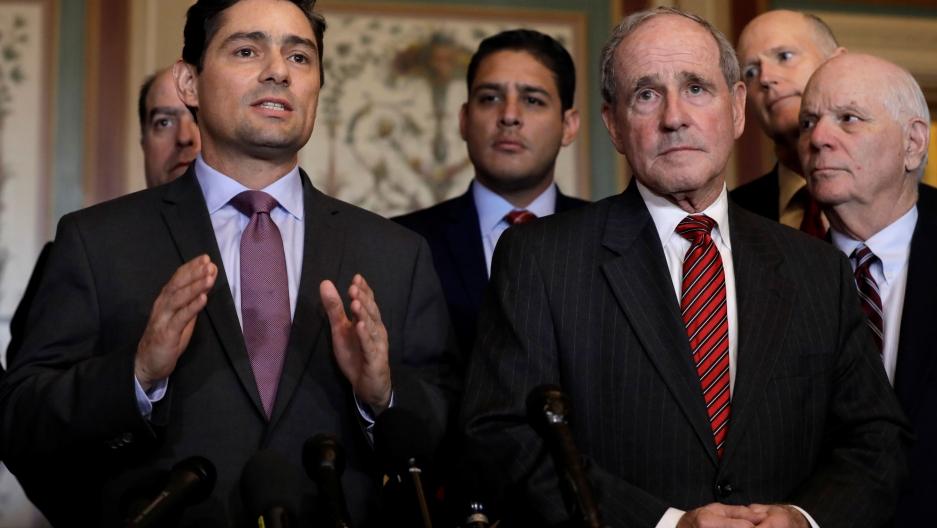 Carlos Alfredo Vecchio gestures while standing next to Senator Jim Risch