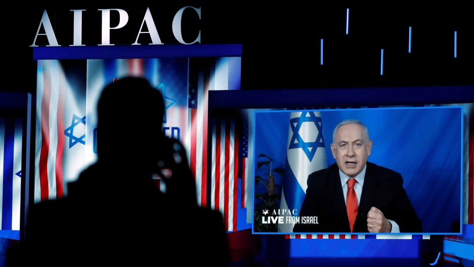 Benjamin Netanyahu speaks to a conference via video chat