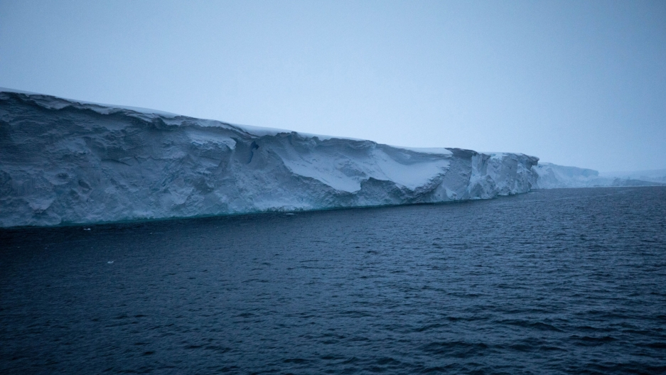 The eastern ice tongue of Thwaites Glacier is shown rising out of deep blue ocean waters.