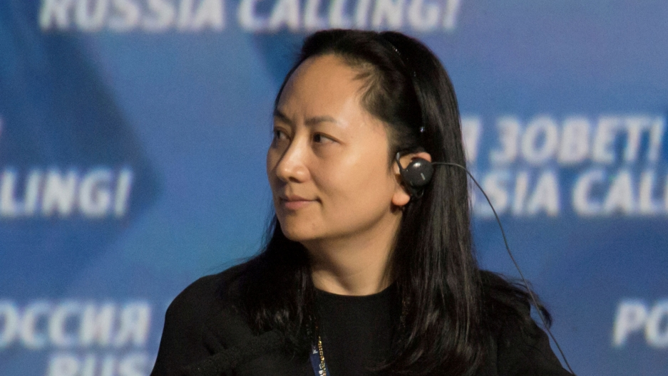 Meng Wanzhou is show in a profile photograph looking to her right and wearing an audio device in her ear.