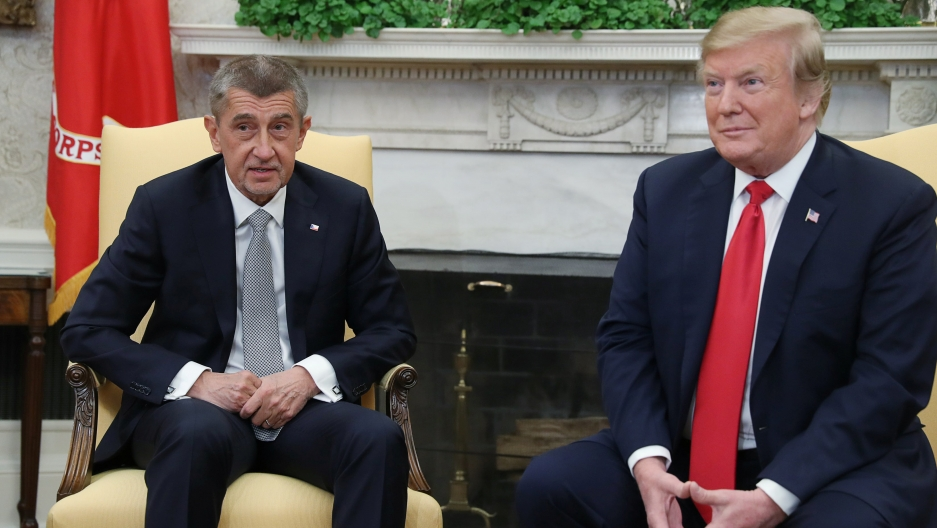 Andrej Babis sits next to Trump.