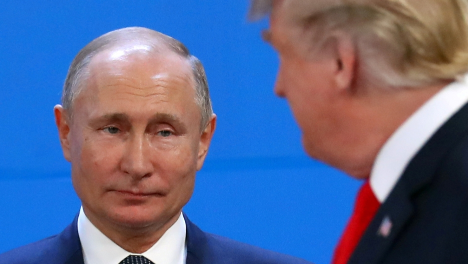 A close up of Putin looking at Trump