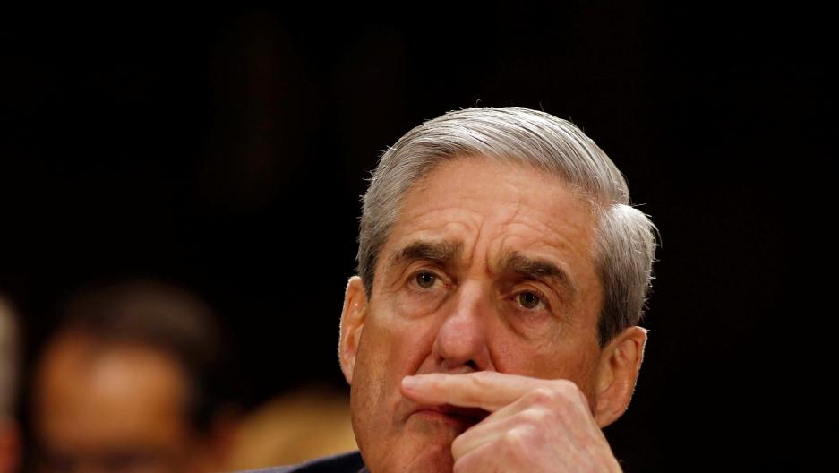 Mueller has a pensive face.