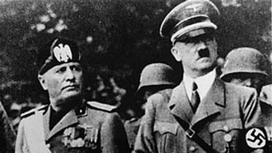 a black and white photo of Benito Mussolini and Adolf Hitler standing next to each other