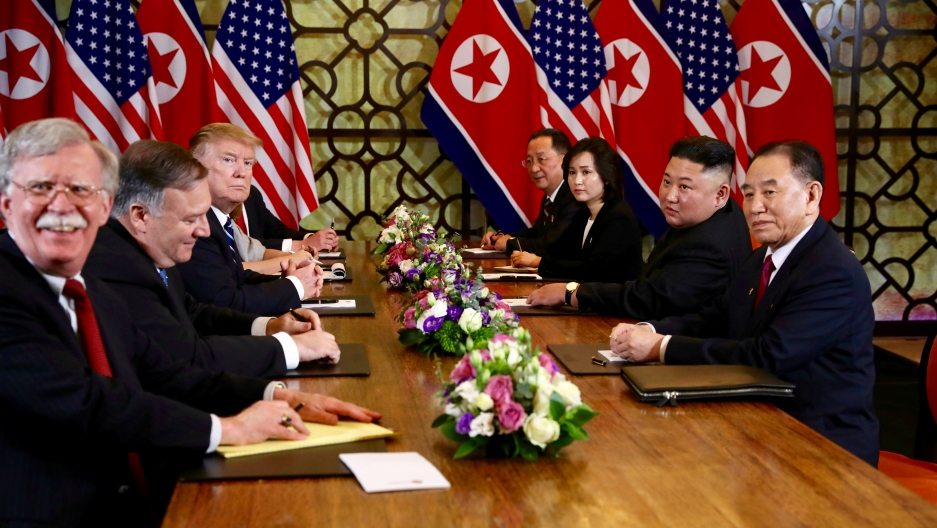 US President Donald Trump and North Korea's leader Kim Jong-un look on while White House national security adviser John Bolton reacts during the extended bilateral meeting in the Metropole Hotel alongside US Secretary of State Mike Pompeo, North Korean Fo