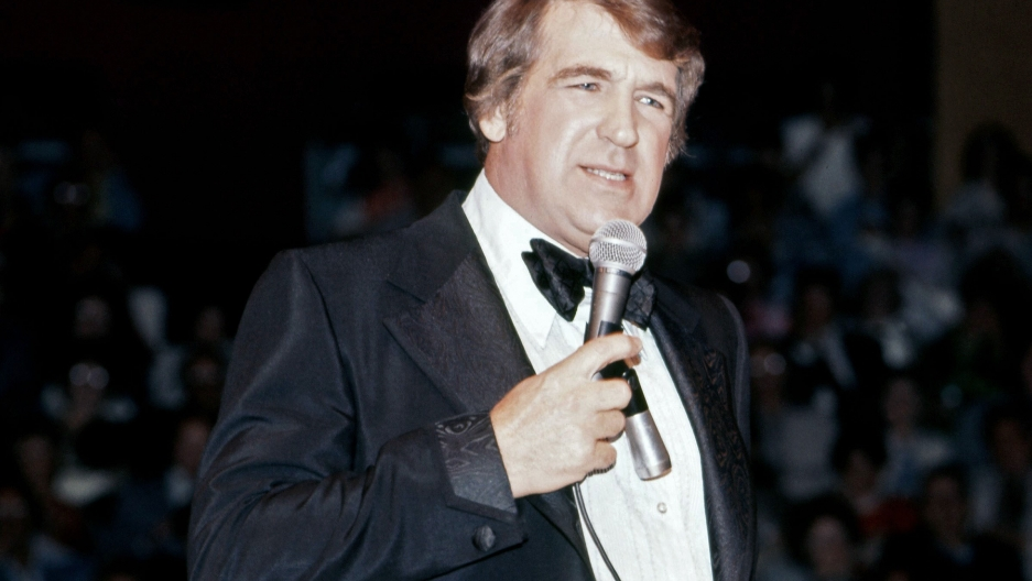 Comedian Shecky Greene performs in 1976.
