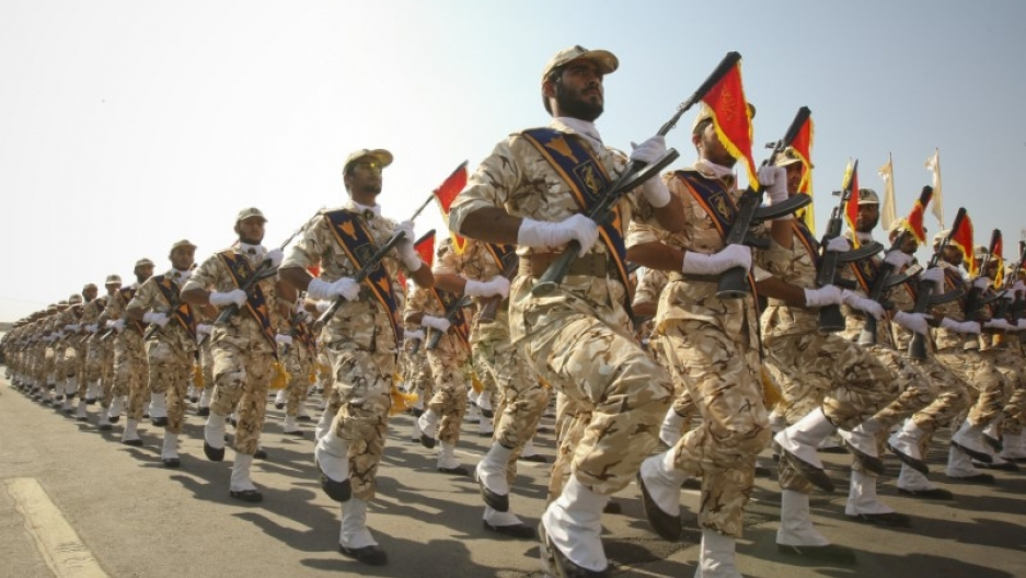 A block of soldiers marches in uniform