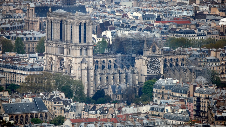 A wide photograph showing the city of Paris with the Notre-Dame Cathedral in the middle of the frame.