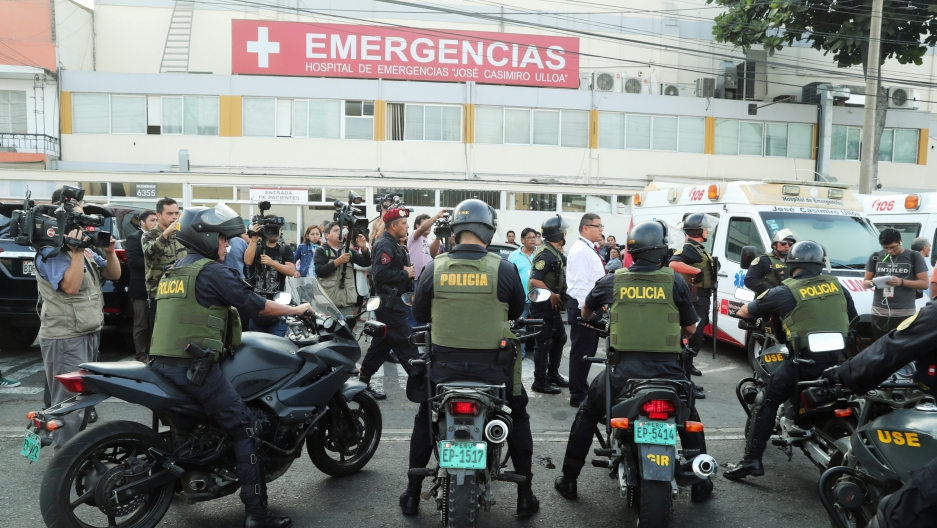 outside a hospital in peru, many police