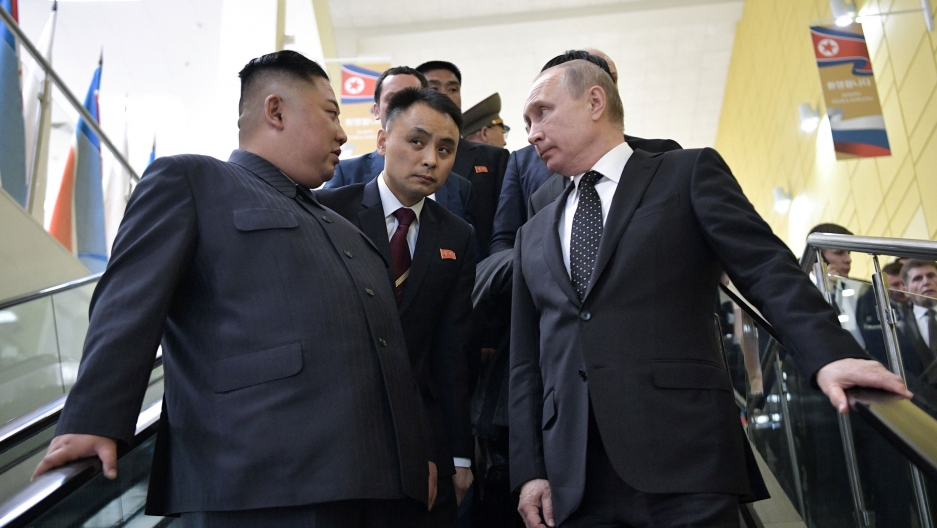 Russia's President Vladimir Putin and North Korea's leader Kim Jong-un are shown standing next to each other on a stairwell.
