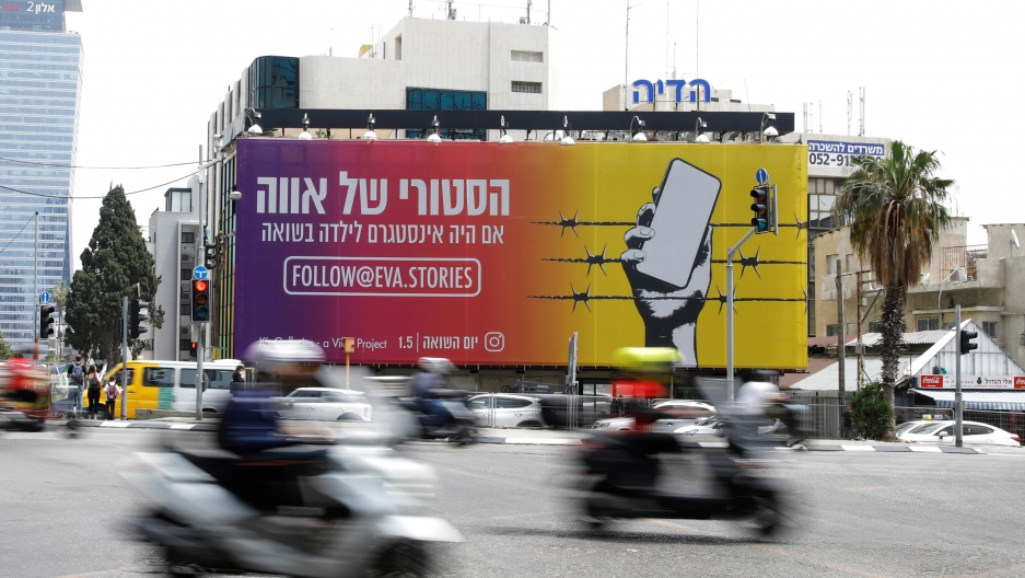 """billboard near a busy intersection advertises """"Eva's Stories"""""""