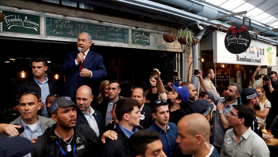 Israeli Prime Minister Benjamin Netanyahu speaks to a crowd during a visit to the Mahane Yehuda Market in Jerusalem one day ahead of Israeli national elections on April 8, 2019.