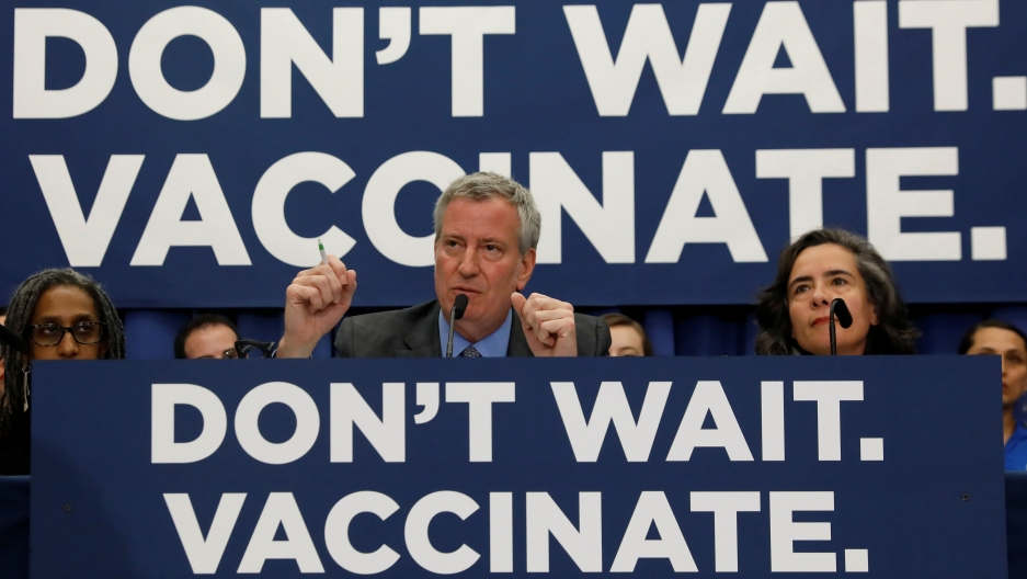 don't wait, vaccinate signs