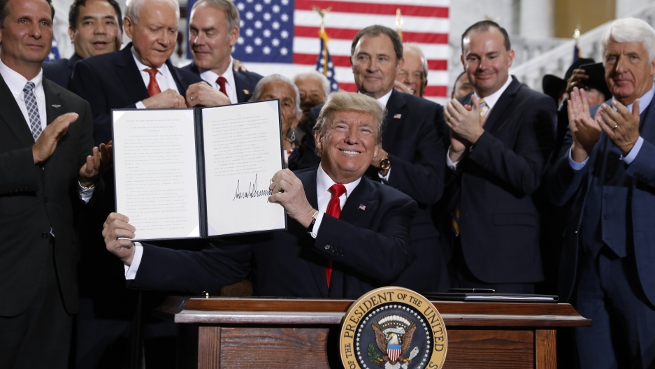 US President Donald Trump displays an executive order