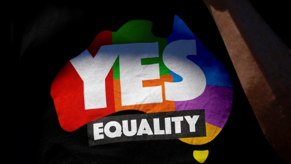 A supporter of the 'Yes' vote for marriage equality wears a shirt as he celebrates