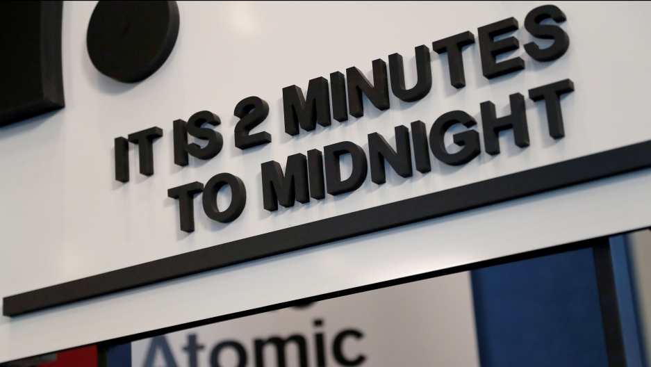 "A sign reads: ""It's 2 minutes to midnight"""