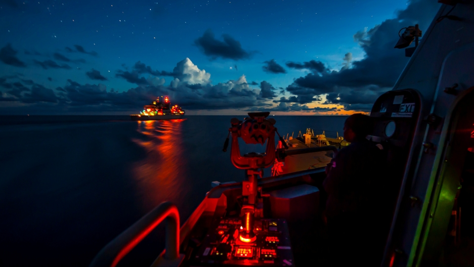 war ships at night