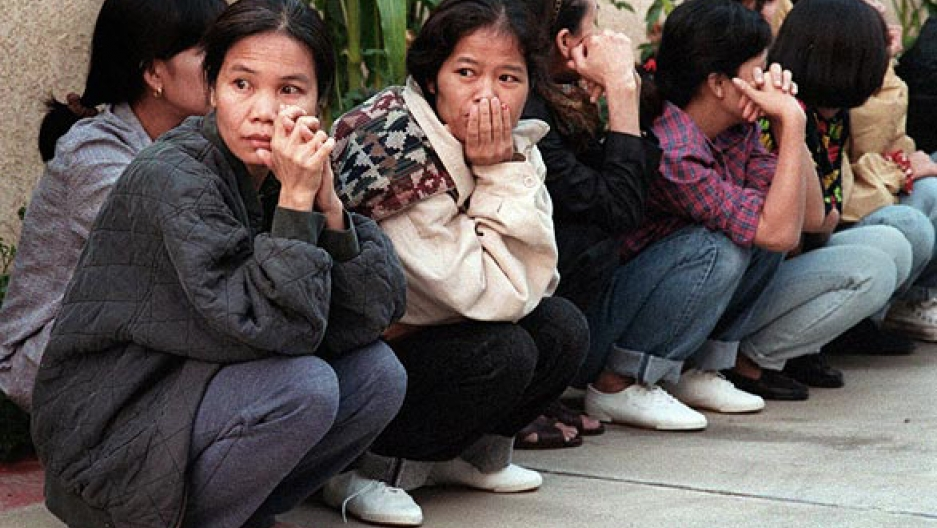 Thai women sitting on a sidewalk in El Monte, California