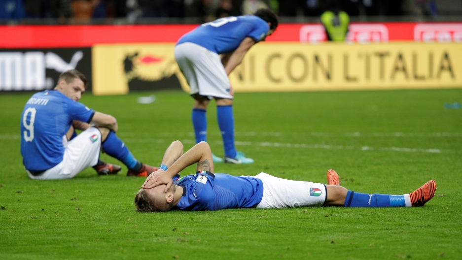 Italy players look dejected after their game with Sweden in a qualifying match for the 2018 FIFA World Cup in Russia
