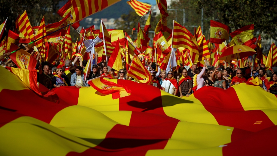 Pro-unity supporters take part in a demonstration in central Barcelona