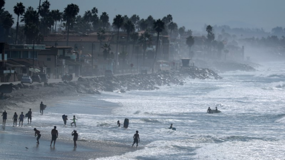 People cool off at the beach during a Southern California heat wave in Oceanside, California, U.S., October 24, 2017.