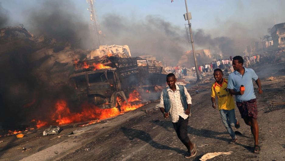 Civilians evacuate from the scene of an explosion in the Hodan district of Mogadishu, Somalia.