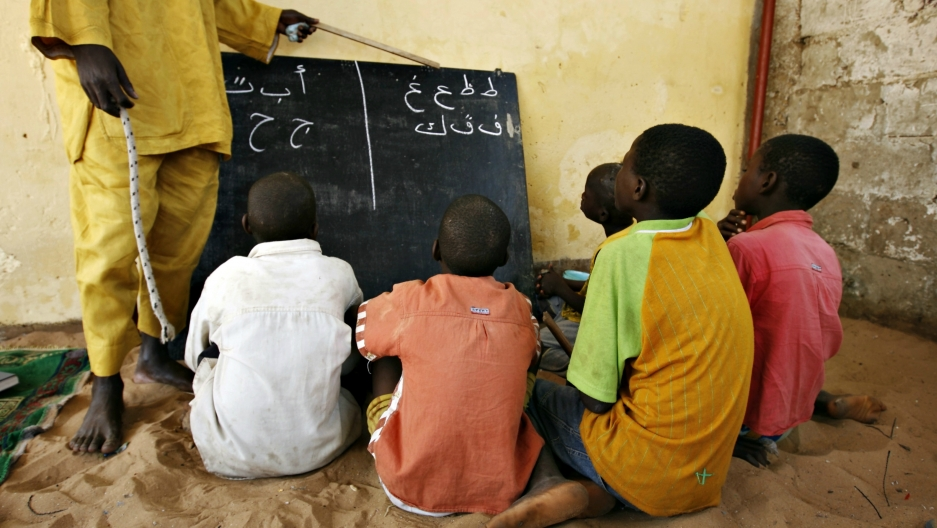 Students learn Arabic script at a Quranic school on the outskirts of Senegal's capital Dakar, May 7, 2008.