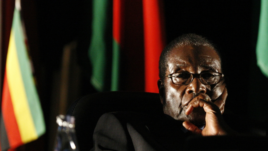 Zimbabwean President Robert Mugabe watches a video presentation during the summit of the Southern African Development Community in Johannesburg, Aug. 17, 2008. Mugabe ruled for 37 years before resigning on Nov. 21, 2017, following a military takeover.