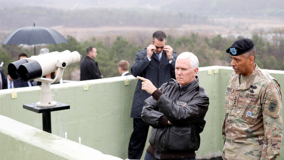 Vice President Mike Pence points towards North Korea