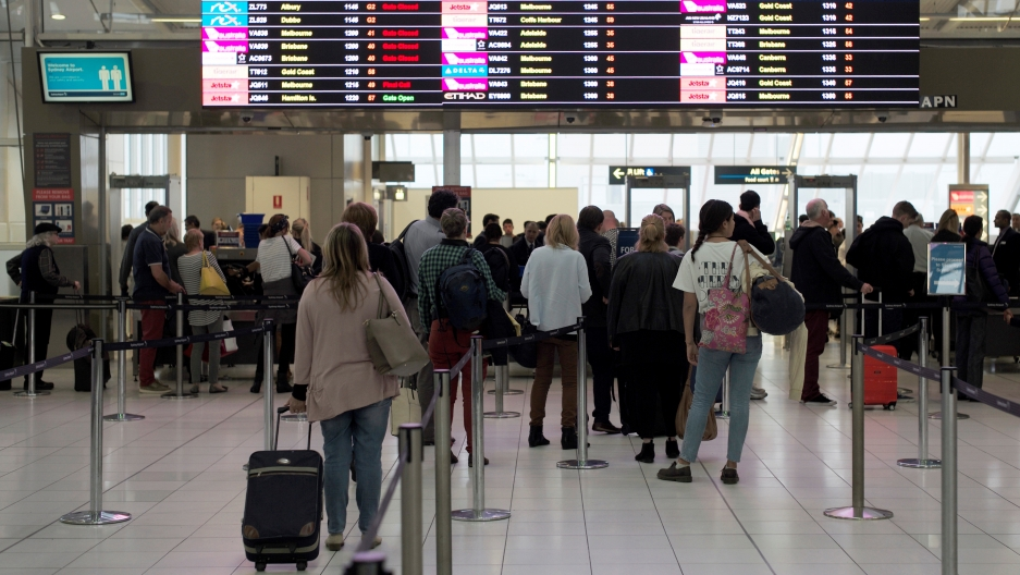 Passengers wait to undergo security checks at Sydney's Domestic Airport in Australia.