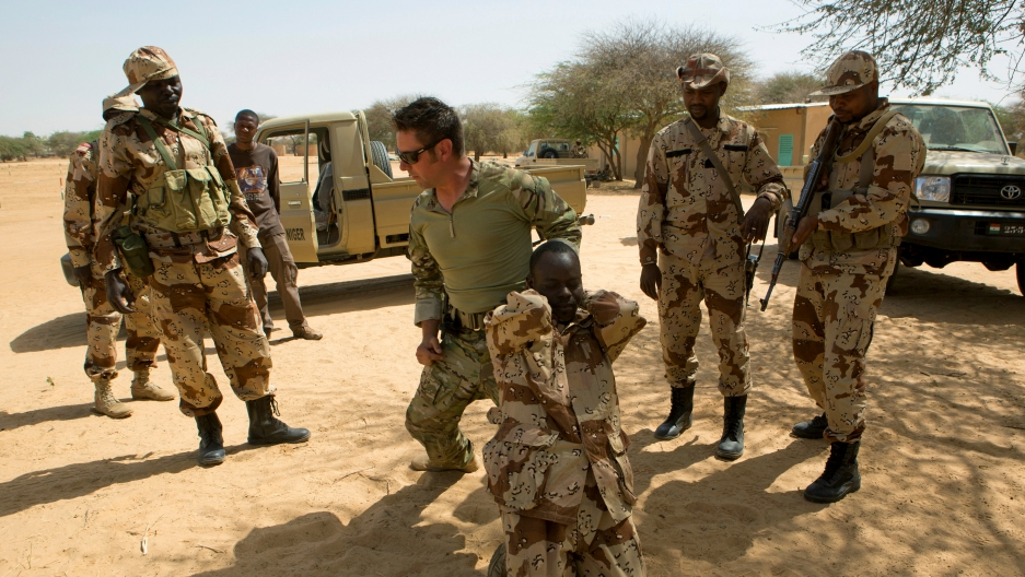 A US special forces soldier demonstrates how to detain a suspect during Flintlock 2014, a US-led international training mission for African militaries, in Diffa, Niger, March 4, 2014.