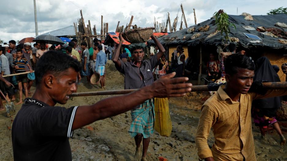 A Rohingya man walks with a basket at Kutupalong refugee camp near Cox's Bazar, Bangladesh, on Oct. 13, 2017.