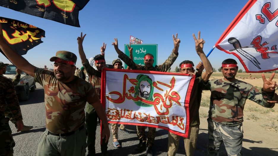 Shi'ite Popular Mobilization Forces (PMF) celebrate on the outskirts of Kirkuk, Iraq