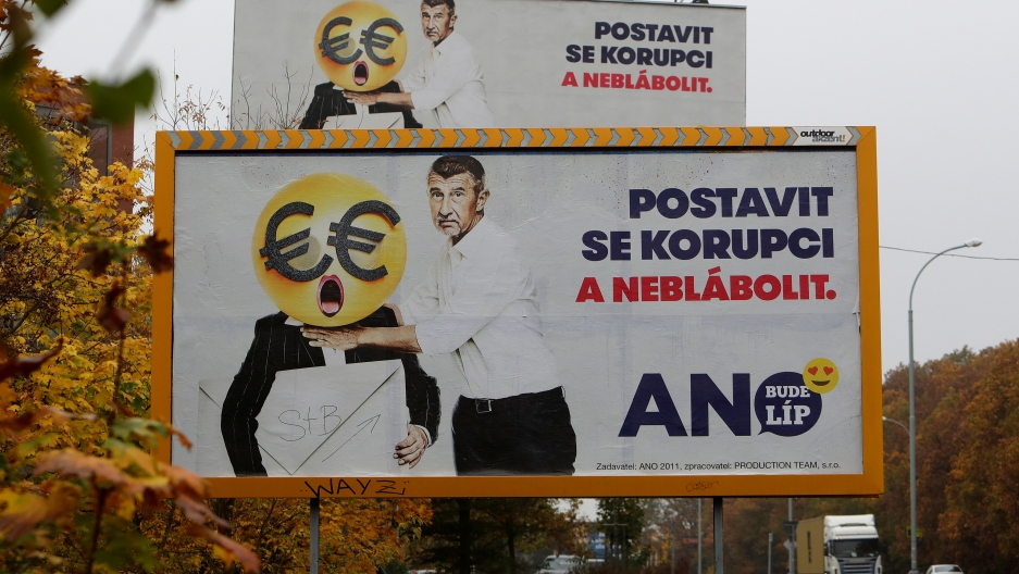 """Election campaign posters for the leader billionaire politician Andrej Babis in Prague, Czech Republic, reading: """"Stand up against corruption and stop babbling."""""""