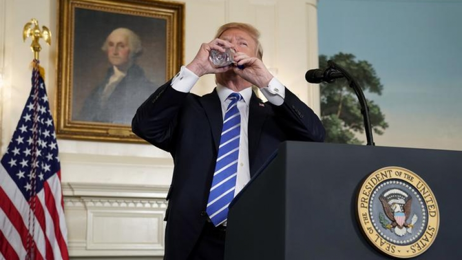 U.S. President Donald Trump takes a drink of water as he speaks about his recent trip to Asia in the Diplomatic Room of the White House in Washington, U.S., November 15, 2017.