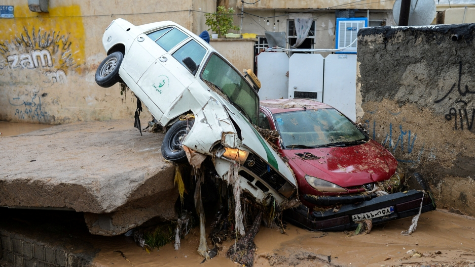 Damaged vehicles are seen after a flash flooding in Shiraz, Iran, March 26, 2019.