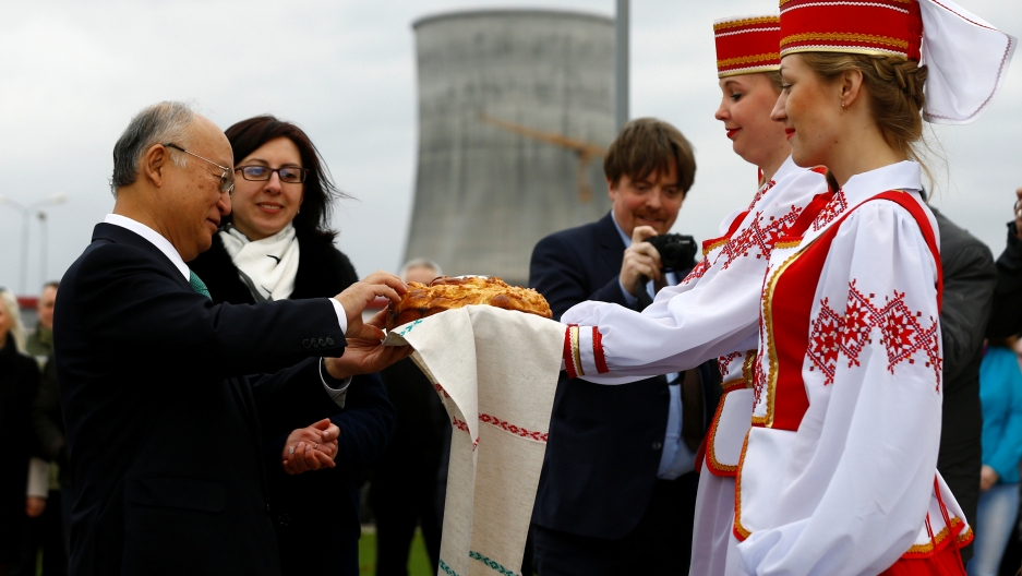 International Atomic Energy Agency (IAEA) Director General Yukiya Amano takes part in a traditional bread and salt ceremony during a visit to the Belarusian nuclear power plant