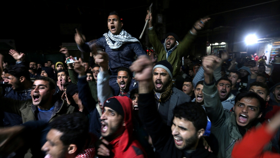 Palestinians react during a protest against Trump's decision to recognize Jerusalem as Israel's capital, in Khan Younis in the southern Gaza Strip, Dec. 7, 2017.
