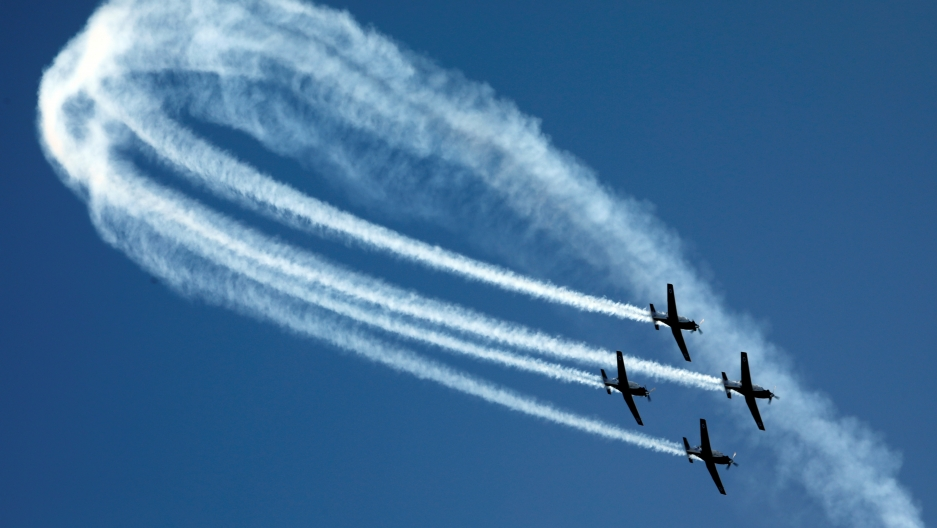 Israeli Air Force T-6 Texan II planes fly in formation during an aerial demonstration at a graduation ceremony for Israeli air force pilots at the Hatzerim air base in southern Israel December 26, 2018.