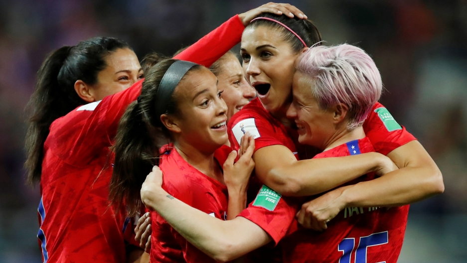 Alex Morgan of the US celebrates scoring their twelfth goal with Megan Rapinoe and teammates.