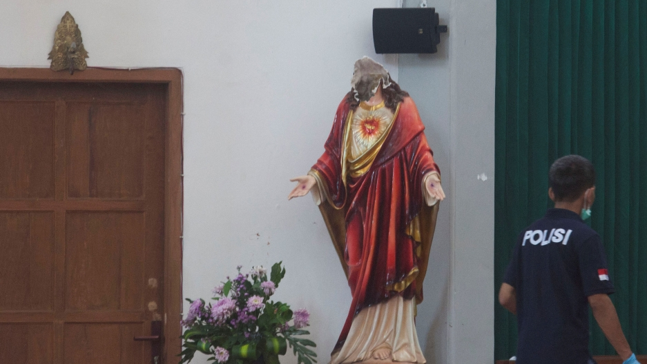 A decapitated religious statue