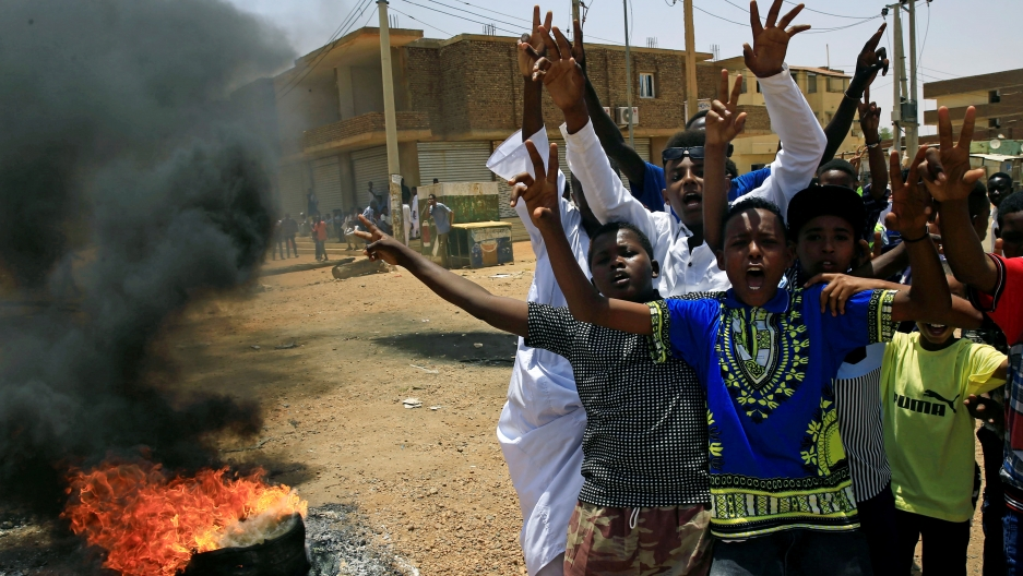 Sudanese protesters gesture and chant slogans at a barricade along a street, demanding that the country's Transitional Military Council hand over power to civilians, in Khartoum, Sudan June 5, 2019