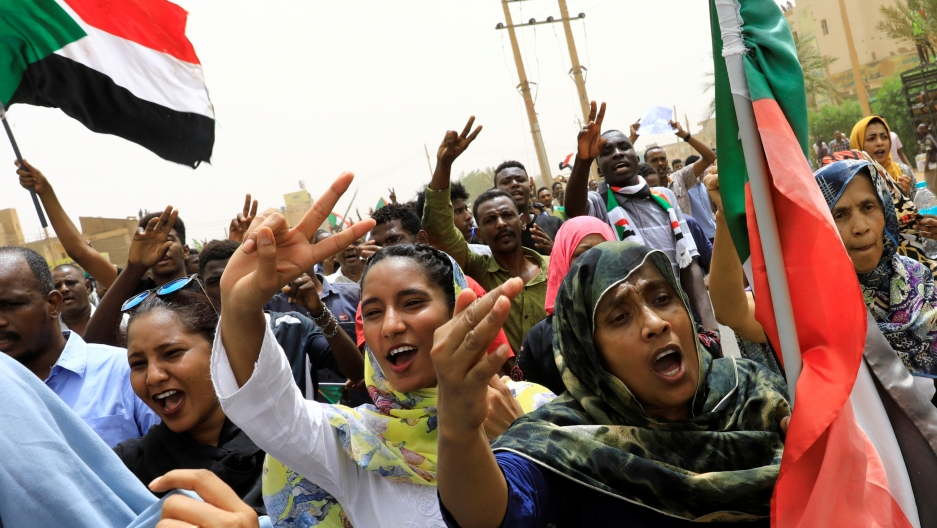 People shout slogans and hold the Sudanese flag as they march on the streets demanding the ruling military hand over to civilians during a demonstration in Khartoum, Sudan June 30, 2019.