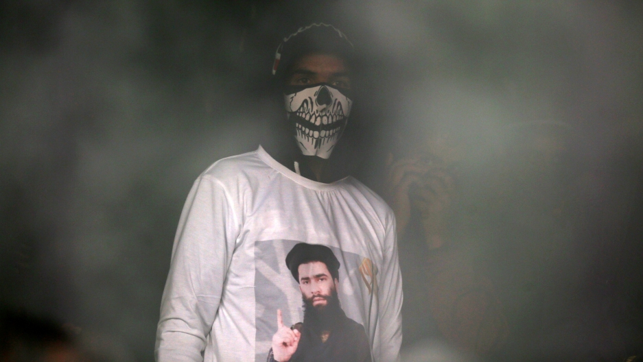 A man wearing a T-shirt with an image of Zakir Rashid Bhat in India's Kashmir region