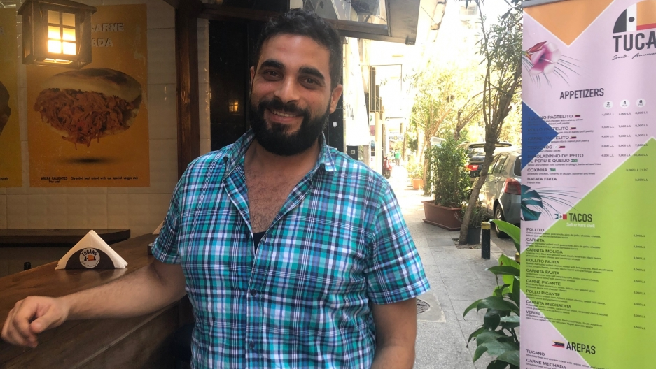 Firas Yordi, a Venezuelan of Lebanese descent, in front of his new restaurant in Beirut. He returned to his parents' homeland last year amidst Venezuela's financial crisis.