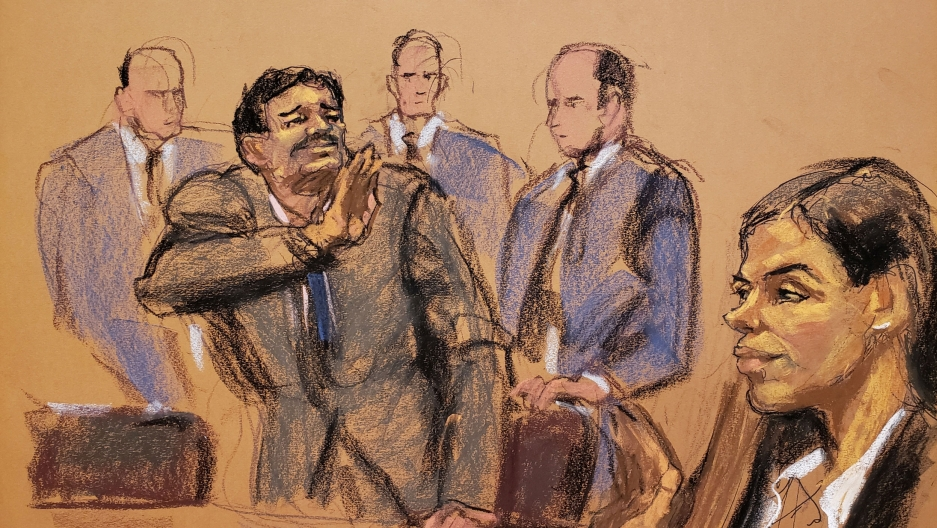 A court room sketch featuring a man turning to his left and waving toward a woman in the bottom right corner.